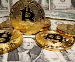 FILE PHOTO: Representations of virtual currency Bitcoin are placed on U.S. Dollar banknotes in this illustration taken May 26, 2020. REUTERS/Dado Ruvic/Illustration/File Photo